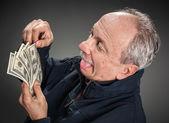 Para ile mutlu bir adam — Stok fotoğraf