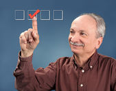 Old man votes — Stock Photo