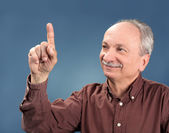 Old man pointing up — Stock Photo