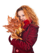 Girl with yellow autumn leaves — Stockfoto