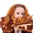 Girl with yellow autumn leaves — Stock Photo