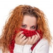 Red-haired girl covers her face with scarf — 图库照片