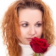 Woman with red rose — ストック写真