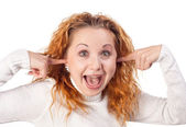 Girl closes her ears by hands — Stock Photo
