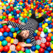 Boy playing with balls — Stock Photo