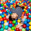 Foto Stock: Boy playing with balls