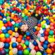 Stock Photo: Boy playing with balls
