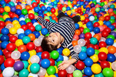 Boy playing with balls — Foto Stock