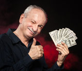 Old man with dollar bills — Stock Photo