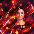 Attractive brunette girl with bokeh lights — Stock Photo