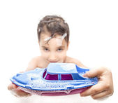 Boy playing in the bath with a toy boat — Stock Photo