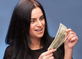 Surprised woman with dollar bills — Stock Photo