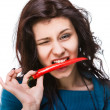 Woman holding red hot chili pepper in mouth — Стоковая фотография