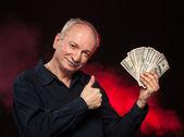 Old man with dollar bills — Stock Photo
