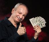 ドル札を歳の男性 — ストック写真