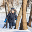 Cute boy in the winter park — Stockfoto