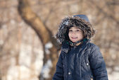 Cute boy in the winter park — Stock Photo