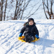 Sledding at winter time - Stock Photo
