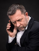 Business man speaks on a mobile phone — Stock Photo