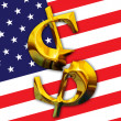 Broken gold dollar on American flag background — Stock Photo