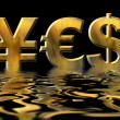 Word YES written by gold symbols of yen, dollar and euro — Stock Photo