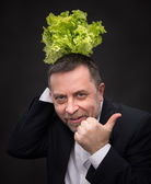 Healthy food. Man holding lettuce — Stock Photo