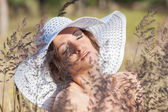 Young woman in white hat — Stock Photo