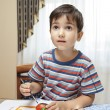 Little boy paints - Stock Photo