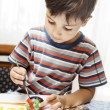 Stock Photo: Little boy paints