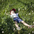 Boy lying on the grass — Stock Photo