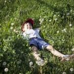 Boy lying on the grass — Stock Photo