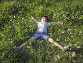 Boy lying on the grass — Foto de Stock