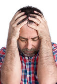 Middle age man suffering from a headache — Stock Photo