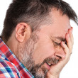 Stock Photo: Elderly msuffering from headache
