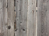 Old gray wooden fence panels — Stock Photo