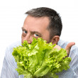 Man holding lettuce isolated on white — Стоковая фотография