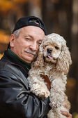 Old man with dog — Stock Photo