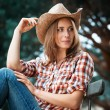 Stock Photo: Sexy cowgirl.