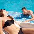 Stock Photo: Couple in love near swimming pool