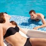 Couple in love near swimming pool — Stock Photo