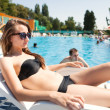 Woman near swimming pool — Foto de Stock