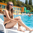 Womnear swimming pool — Stock Photo #30169345