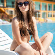 Womnear swimming pool — Stock Photo #30169497