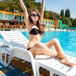 Womnear swimming pool — Stock Photo #30169561