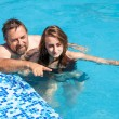 Father and daughter swimming in poo — Stock Photo #30233619