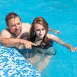 Father and daughter swimming in poo — Stock Photo #30233693