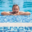 Stock Photo: Middle-aged min swimming pool