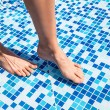 Overhead view of woman's legs in pool — Stock Photo