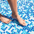 Overhead view of woman's legs in pool — Stock Photo #30233809