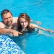Father and daughter swimming in poo — Stock Photo #30233891